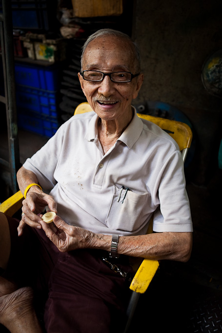 Mr Achoon in yellow chair, Bangkok Chinatown