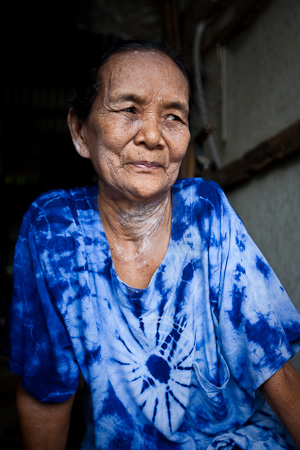 Khun Yai Faa in her home in the slums