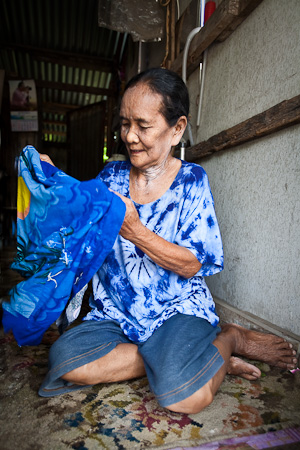 K Yai Faa examines her sarong for the Songkran celebrations