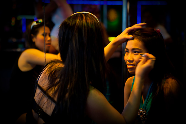 Girls preparing for work, streets of Pattaya