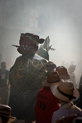 Dragon emerges through the smoke, Festa Major, Sitges in Spain