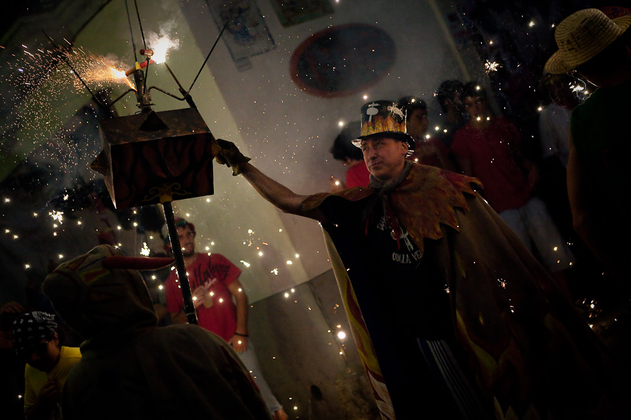 Chief devil ignites the firecrackers, Festa Major, Sitges in Spain
