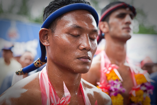 Muay  Thai fighters wear ceremonial headbands and garlands