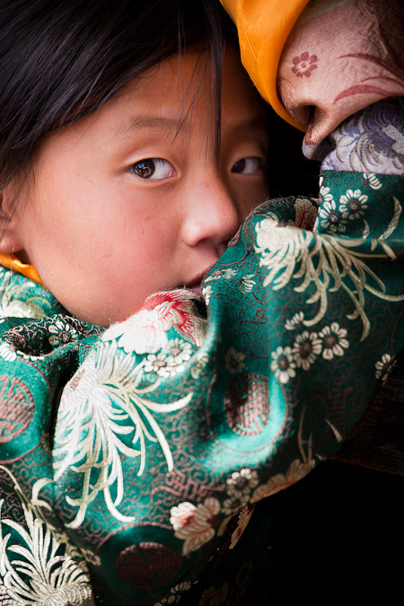 A young spectator at the Tamshingphala Tsechu.