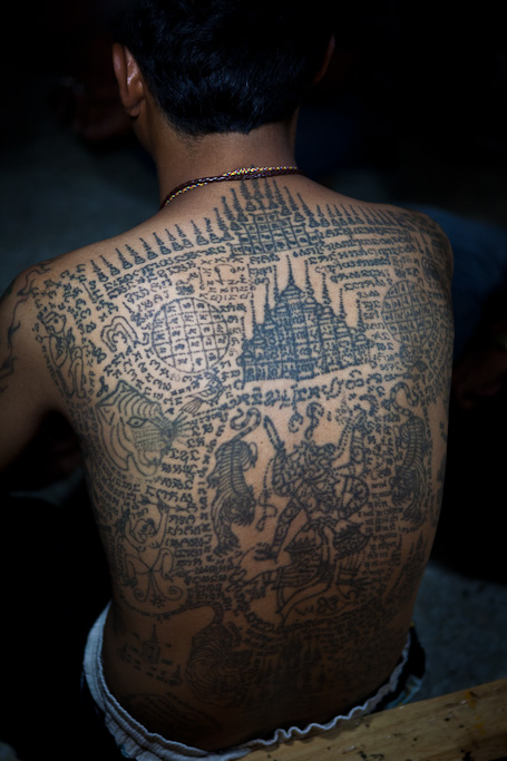 Wat Bang Phra, Wai Khru Tattoo Festival, Thailand, tattoos on man's back