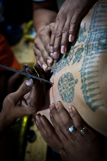 Wat Bang Phra, Wai Khru Tattoo Festival, Thailand, needle creating tattoo