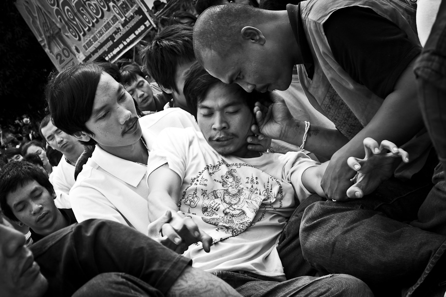 Wat Bang Phra, Wai Khru Tattoo Festival, Thailand, rubbing ear, calm now