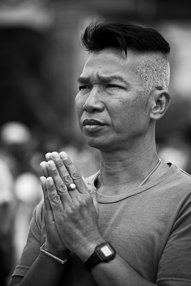 Wat Bang Phra, Wai Khru Tattoo Festival, Thailand, man praying