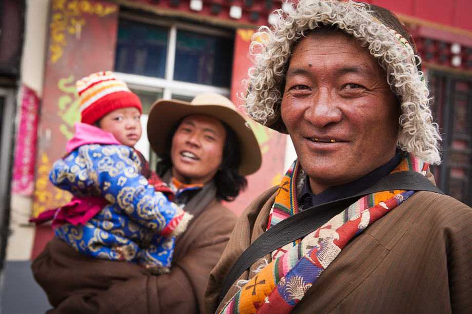 Men on the colourful streets of Maduo, Qinghai, Tibetan Plateau
