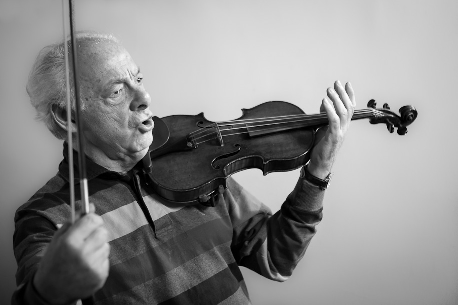 György Pauk demonstrating on violin